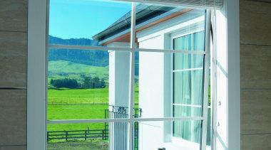 Awning window overlooking countryside. - Bathroom window - architecture, daylighting, door, glass, window, teal
