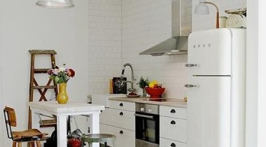 This white Smeg fridge blends just right against home, home appliance, interior design, kitchen, room, gray