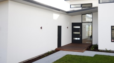 Bold modern lines define this entry built by architecture, door, facade, home, house, property, real estate, window, white