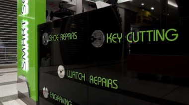 Kiosk services displayed on a glossy black background advertising, green, technology, black, gray