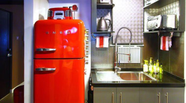 This red Smeg fridge just fits into the home appliance, interior design, kitchen, kitchen appliance, major appliance, refrigerator, room