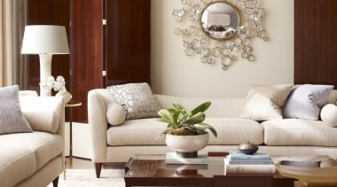 """Upholstery helps set the foundation for how a coffee table, couch, floor, flooring, furniture, hardwood, home, interior design, living room, loveseat, room, table, wood, gray, brown"
