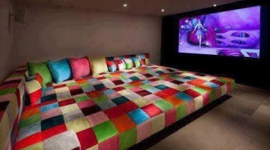 Huge TV screen and humongous couch - Cinema bed sheet, interior design, room, red