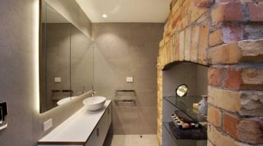 The double sided fireplace links bedroom and ensuite. bathroom, floor, interior design, room, tile, brown, orange