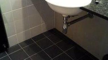 Before the renovation. Standard tiles on wall and bathroom, ceramic, floor, flooring, hardwood, interior design, plumbing fixture, property, room, sink, tile, toilet, toilet seat, black