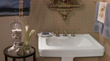 A traditional style Powder Room with upholstered fabric bathroom, bathroom accessory, bathroom sink, ceramic, floor, furniture, home, interior design, plumbing fixture, room, sink, tile, toilet seat, wall, brown