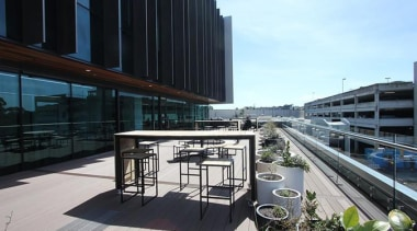 This large beautiful staff decking facility was build apartment, architecture, building, city, condominium, corporate headquarters, headquarters, metropolitan area, mixed use, real estate, reflection, urban design, black