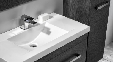Squared external edges paired with a sweeping basin angle, bathroom, bathroom accessory, bathroom cabinet, bathroom sink, black, drawer, floor, furniture, plumbing fixture, product, product design, sink, tap, black, white