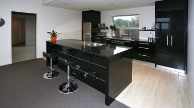 Black lacquered kitchen features in this home built countertop, floor, flooring, interior design, kitchen, property, room, gray, black