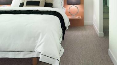 A smart-looking, chunky loop pile that is ideal bed, bed frame, bed sheet, bedroom, carpet, duvet cover, floor, flooring, furniture, hardwood, home, interior design, laminate flooring, room, suite, wall, wood, wood flooring, white, gray
