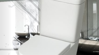 Understated Beauty. Soft lines convey streamlined elegance across bathroom, ceramic, plumbing fixture, product, tap, toilet, toilet seat, white, gray