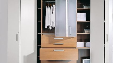 WingLine 780 folding door fitting used in bedroom. angle, cabinetry, chest of drawers, closet, cupboard, filing cabinet, furniture, product design, wardrobe, white, gray