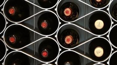 The Echelon modular wine bottle storage system nests black