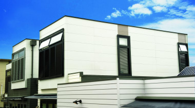 An affordable walling solution, Smooth panels provide designers architecture, building, commercial building, corporate headquarters, elevation, facade, home, house, property, real estate, residential area, siding, window, white
