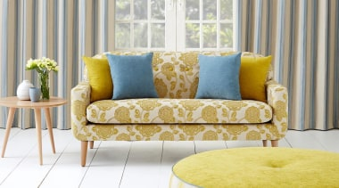 The versatility of our Naomi Collection is deceiving chair, coffee table, couch, floor, furniture, home, interior design, living room, loveseat, sofa bed, studio couch, table, window, window covering, yellow, white, gray