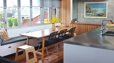 A new window seat provides informal seating to countertop, furniture, interior design, kitchen, real estate, table, gray