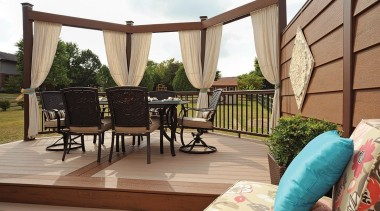 A beautiful example of a colour combination of balcony, deck, home, outdoor structure, property, real estate, white, brown