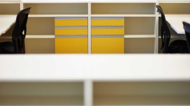 Melteca is used for cubicle division and other angle, floor, furniture, line, office, product, shelf, shelving, yellow, brown, white