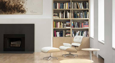 Eames lounge chair and ottoman by Charles and bookcase, chair, floor, flooring, furniture, hearth, interior design, living room, product design, shelf, shelving, table, wall, gray