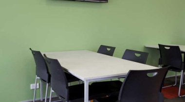 OfficeMax provides a comprehensive furniture solution, a full chair, classroom, desk, floor, flooring, furniture, interior design, office, product design, room, table, wall, green, black