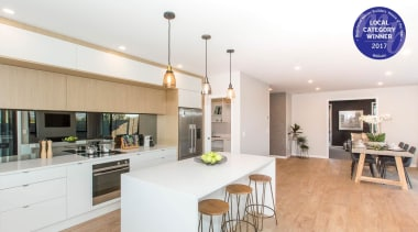 Kitchen and living areas are open plan countertop, interior design, kitchen, property, real estate, white