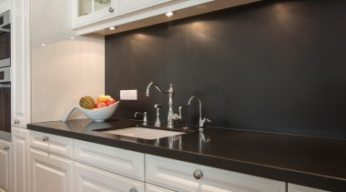 Contemporary technology is combined with timeless aesthetics and cabinetry, countertop, cuisine classique, interior design, kitchen, sink, under cabinet lighting, gray, black