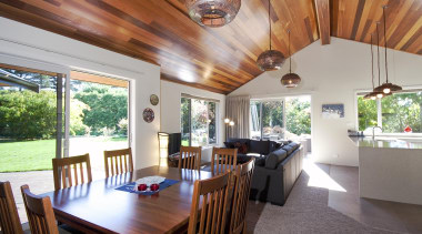 Pitched cedar ceiling adds warmth to the living ceiling, dining room, estate, home, house, interior design, property, real estate, roof, table, gray, brown