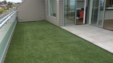 Commercial landscape artificial turf, backyard, floor, flooring, grass, home, house, lawn, plant, property, real estate, residential area, roof, yard, green, gray