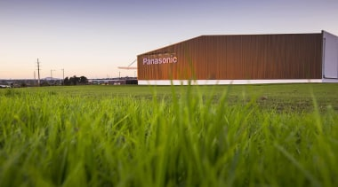 MERIT WINNERPanasonic Building (2 of 4) - Trends architecture, energy, farm, field, grass, grass family, grassland, green, house, lawn, meadow, plain, plant, prairie, rural area, sky, structure, brown