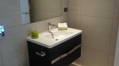 Earthstone talc ivory bathroom floor and wall tiles bathroom, bathroom accessory, bathroom cabinet, floor, interior design, plumbing fixture, product design, room, sink, tile, gray