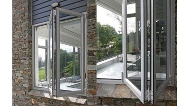 Windowmakers bi-fold windows run on an easy-slide track door, glass, porch, window, white, gray