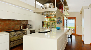 This new kitchen incorporated a huge stainless steel countertop, interior design, kitchen, real estate, white, brown