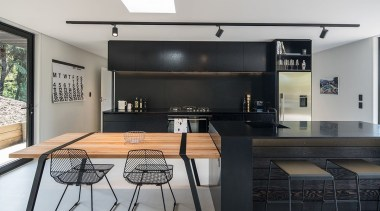 Evelyn McNamara Architecture, AucklandSee the full story house, interior design, kitchen, table, gray, black
