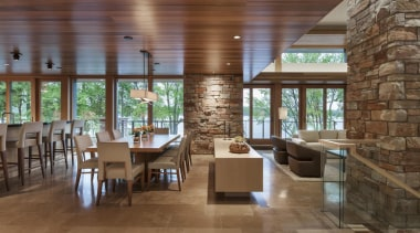 This new house, designed by Charles R Stinson ceiling, flooring, interior design, real estate, restaurant, brown