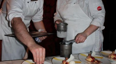 At Euro Bar & Restaurant - At Euro chef, cook, cooking, cuisine, dish, food, meal, profession, professional, gray, black