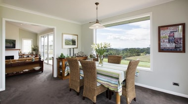 Fowler Homes Tauranga.Gold reserve winner and National finalist dining room, estate, floor, flooring, home, house, interior design, living room, property, real estate, room, table, window, gray