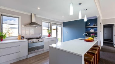 A feature wall in a smoky grey-blue shade countertop, interior design, kitchen, property, real estate, room, gray
