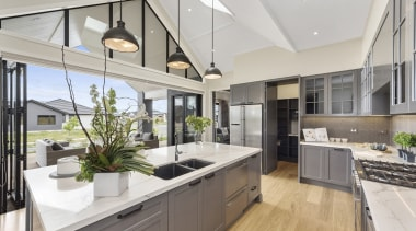 The kitchen forms the hub of this home countertop, interior design, kitchen, real estate, window, gray