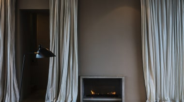 Winner of the Villa Category at the World curtain, fireplace, hearth, home, interior design, room, textile, wall, window, window covering, window treatment, wood, gray, black