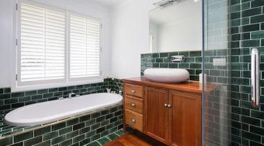 Fowler Homes Tauranga.Gold reserve winner and National finalist bathroom, bathroom accessory, bathroom cabinet, floor, flooring, home, interior design, room, tile, window, white