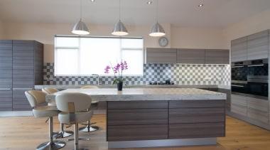 This contemporary Poggenpohl kitchen combines modern Teak cabinetry cabinetry, countertop, cuisine classique, floor, flooring, interior design, kitchen, room, wood flooring, gray