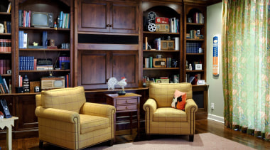 This room is where much of the client's bookcase, cabinetry, furniture, home, interior design, library, living room, room, shelf, shelving, black