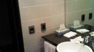 Before the renovation. Standard tiles on wall and bathroom, floor, flooring, interior design, plumbing fixture, public toilet, room, sink, tile, toilet, black, gray