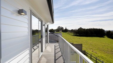 Exterior view from the upper deck - Exterior apartment, balcony, cottage, deck, handrail, home, house, outdoor structure, porch, property, real estate, window, white