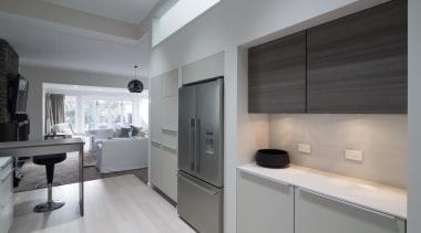 The kitchen highlights a double door stainless steel countertop, floor, interior design, kitchen, real estate, gray