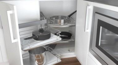 Giamo's Magic Corner boasts a clever design that countertop, furniture, home appliance, kitchen, kitchen appliance, kitchen stove, small appliance, white, gray
