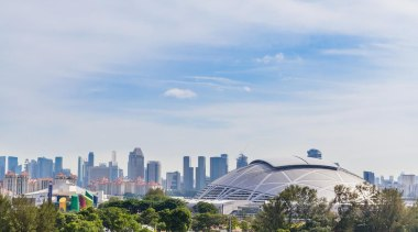 Singapore-based engineering company MHE-Demag provided the roof moving atmosphere of earth, city, cityscape, cloud, daytime, downtown, horizon, landmark, metropolis, metropolitan area, residential area, sky, skyline, skyscraper, suburb, tower block, tree, urban area, white