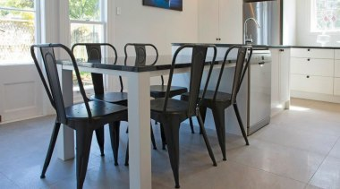 frame and flat panel, black granite, lower table chair, dining room, floor, flooring, furniture, hardwood, property, room, table, gray