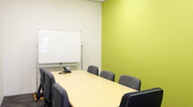 OfficeMax provides a comprehensive furniture solution, a full ceiling, conference hall, desk, furniture, interior design, office, table, yellow, white