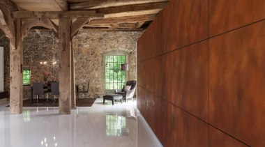 An imposing wall of weathered corten steel one architecture, ceiling, estate, floor, home, house, interior design, wood, brown